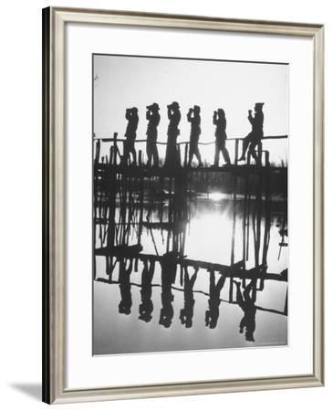 Bird Counters of the Audubon Society Standing on a Bridge-Francis Miller-Framed Photographic Print