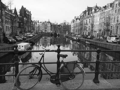 Black and White Imge of an Old Bicycle by the Singel Canal, Amsterdam, Netherlands, Europe-Amanda Hall-Photographic Print