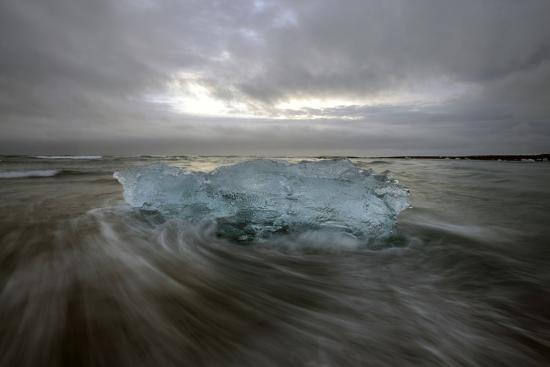 Black Sand Beach with Ice and Small Icebergs-Raul Touzon-Photographic Print