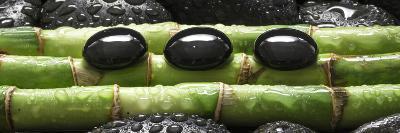 Black Stones on Bamboo-Uwe Merkel-Photographic Print