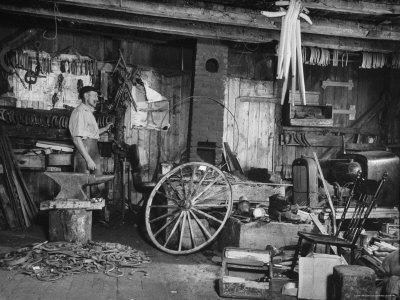 Blacksmith Working in His Shop-John Phillips-Photographic Print