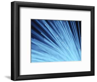 Blue Fiber Optic Wires Against Black Background