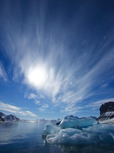 Blue Ice under a Blue Sky with Streaky Clouds, Hornsund, Spitsbergen Island, Svalbard, Norway-Ralph Lee Hopkins-Photographic Print