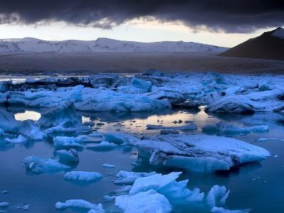 Blue Icebergs Floating on the Jokulsarlon Glacial Lagoon at Sunset, South Iceland, Iceland-Lee Frost-Photographic Print