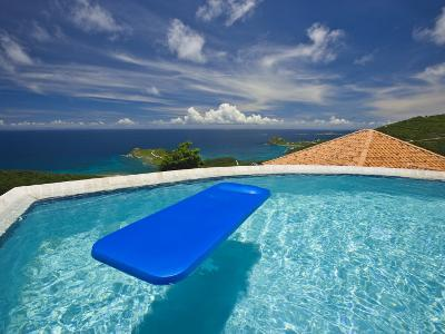 Blue Raft Floats in a Pool Overlooking the Caribbean Sea-Michael Melford-Photographic Print