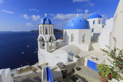 Blue Roofed Churches and Homes are Everywhere on the Island. Santorini. Greece-Tom Norring-Photographic Print
