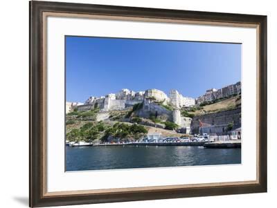 Blue sea frames the medieval old town and fortress, Bonifacio, Corsica, France, Mediterranean, Euro-Roberto Moiola-Framed Photographic Print