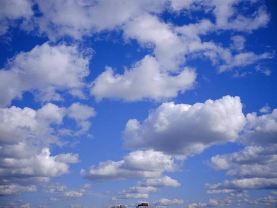Blue Sky and Puffy White Clouds-Fraser Hall-Photographic Print