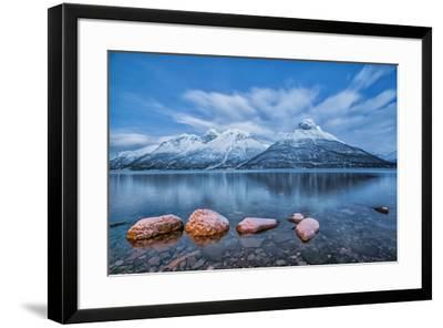Blue sky at dusk and snowy peaks are reflected in the frozen sea at Oteren Storfjorden Lapland Lyng-ClickAlps-Framed Photographic Print