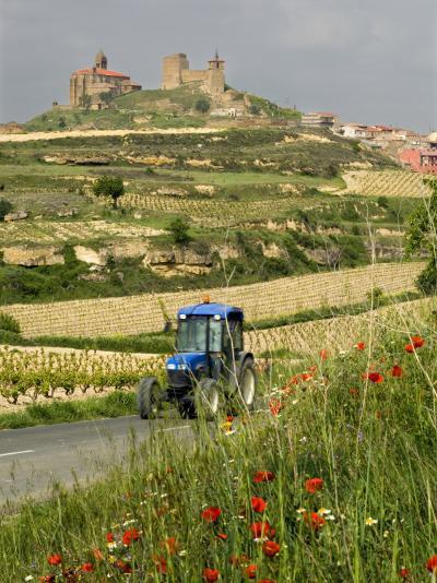 Blue tractor on rural road, San Vicente de la Sonsierra Village, La Rioja, Spain-Janis Miglavs-Photographic Print