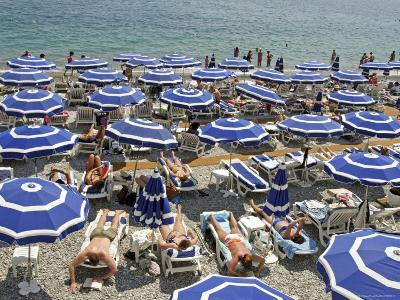 Blue Umbrellas and People Crowd Beach-Russell Mountford-Photographic Print