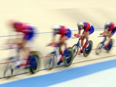 Blurred Action of Cycliing Team Onthe Track-Chris Trotman-Photographic Print