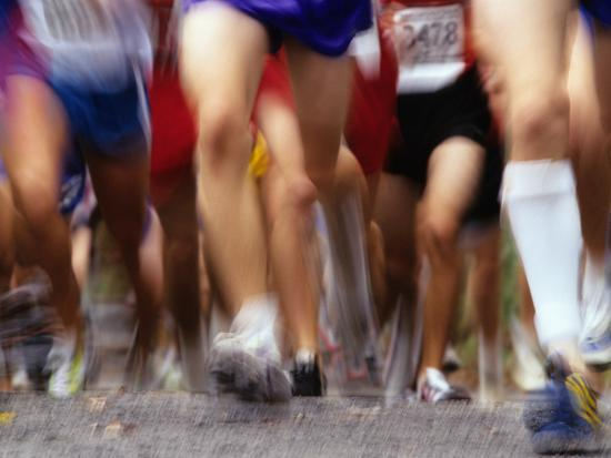 Blurred Action of Runner's Legs Competing in a Race--Photographic Print