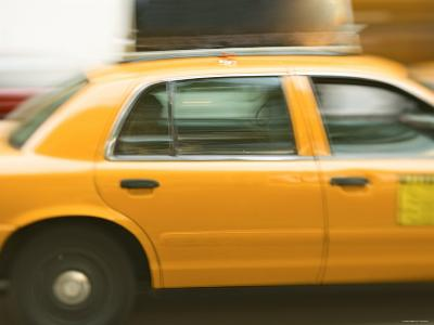 Blurred Motion of a Speeding Taxi Cab on a Busy Street--Photographic Print