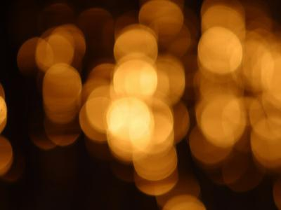 Blurry Orange Lights Illuminating Against a Black Background--Photographic Print