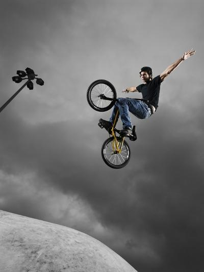 BMX Biker Performing Tricks--Photographic Print
