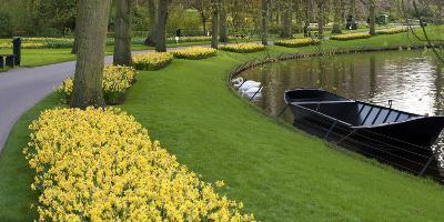 Boat on Keukenhof Gardens Lake in Early Spring-Anna Miller-Photographic Print