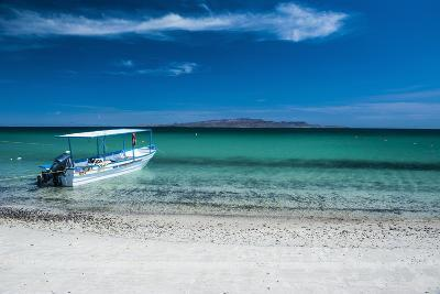 Boat on Playa Tecolote with Isla Espiritu Santo in the Background-Michael Runkel-Photographic Print