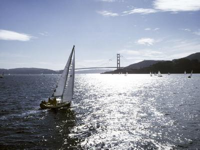 Boat Sails Toward the Golden Gate Bridge on San Francisco Bay-Rex Stucky-Photographic Print