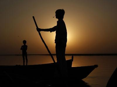 Boatman Prepares to Anchor His Boat, after the Day's Work in River Ganges, in Allahabad, India--Photographic Print