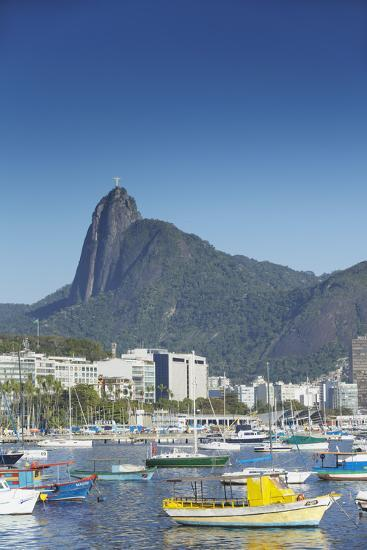 Boats Moored in Harbour with Christ the Redeemer Statue in Background, Urca, Rio de Janeiro, Brazil-Ian Trower-Photographic Print