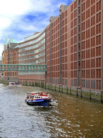 Boats Pass by Waterfront Warehouses and Lofts, Speicherstadt Warehouse District, Hamburg, Germany-Miva Stock-Photographic Print