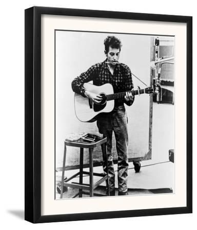Bob Dylan Playing Guitar and Harmonica into Microphone. 1965--Framed Art Print