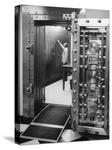 Bank Employee Selecting a Safety Deposit Box for a Customer Inside Vault Area by Bob Gomel