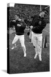 """Notre Dame Cheerleaders Work the Crowd During the 1966 """"Game of the Century"""" Against Michigan State by Bob Gomel"""