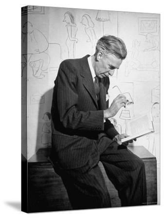 Cartoonist James Thurber Posing with His Work