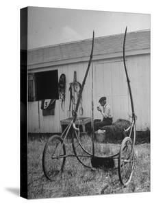 Elderly Horseman Relaxing Near Lenn County Fair by Bob Landry