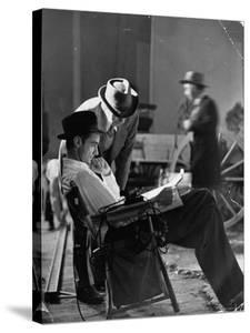 """Millionaire Howard Hughes/Movie Studio Owner Studying Script on the Movie Set for """"The Outlaw"""" by Bob Landry"""