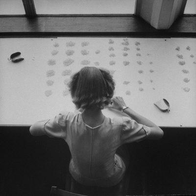 Newly Trained Girl Sorting Thousands of Dollars Worth of Diamonds