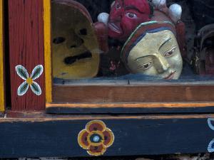 Ceremonial Mask in Shop Window, Paro, Bhutan by Bob Winsett