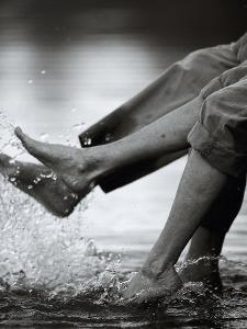 Couple Splashing Water withFeet by Bob Winsett