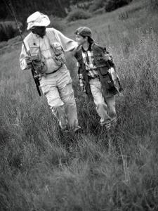 Grandfather and Boy in Field with Fishing Poles, CO by Bob Winsett