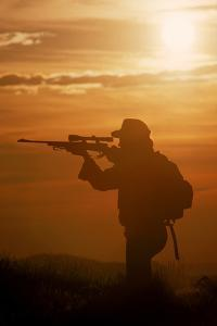 Hunter with Sunset Background by Bob Winsett