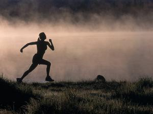 Silhouette of Woman Trail Running, CO by Bob Winsett