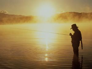 Silhouetted Fly Fisherman, Dillon Reservoir by Bob Winsett