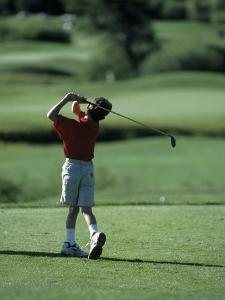 Young Boy Playing Golf, Breckenridge, CO by Bob Winsett