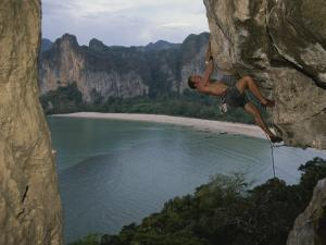 A Climber Negotiates an Overhang on Railay Beach by Bobby Model
