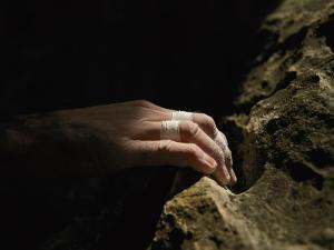 A Close View of a Climbers Hand Utilizing a Natural Hold by Bobby Model