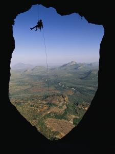 A Man Rappelling to His Bivouac on the East Face of Poi by Bobby Model