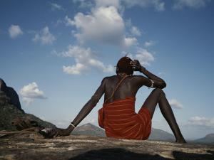 A Samburu Goatherd Takes a Break on the Top of a Hill by Bobby Model