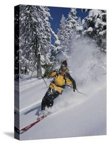 A Skier Cuts Through Some Untouched Powder in Montana by Bobby Model