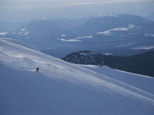 A Skier Explores a Vast Expanse of Untracked Powder by Bobby Model