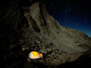 Campsite by the Merlin, a Rock Face in Wyoming by Bobby Model