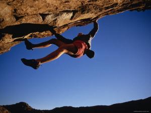 Climber Scaling an Overhang in Texas by Bobby Model