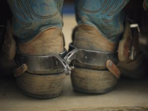 Close up Detail of Cowboy Boots with Well-Worn Spurs by Bobby Model