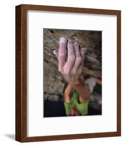 Hand Reaches Up for a Small Hold on a Rock Climb in Wyoming by Bobby Model